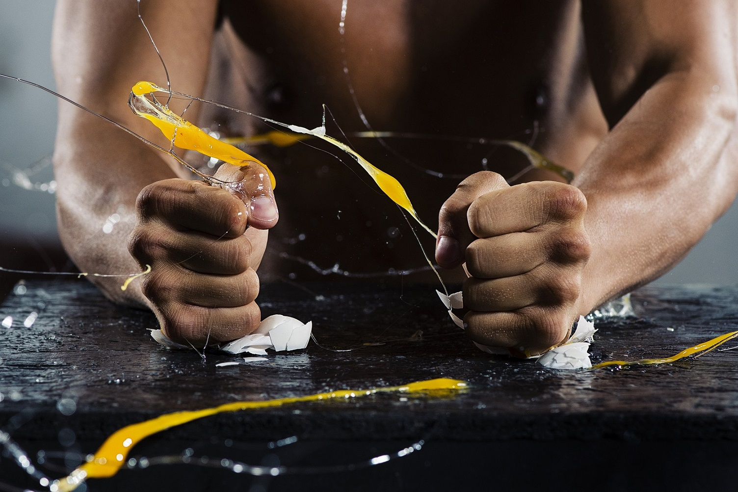Image of MMA artist Tom 'Fire Kid' Duquesnoy crushing two eggs with his fists, showing the split-second moments of impact. Image taken by professional sports photographer Tom Miles using the Nikon D500, which shoots at 10 frames per second.