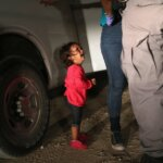 Crying Girl on the Border, John Moore, Getty Images.