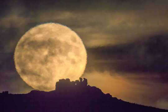 Supermoon over Three Fingers Rock, Caer Caradoc Shropshire UK. The Times cover photo © Andrew Fusek Peter